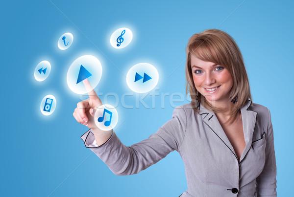 woman pressing media player button Stock photo © ra2studio