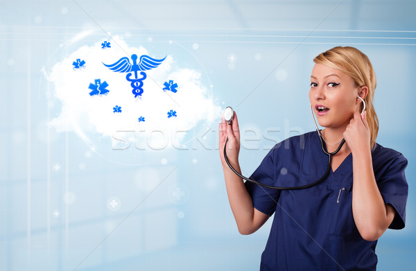Young doctor with abstract cloud and medical icons Stock photo © ra2studio