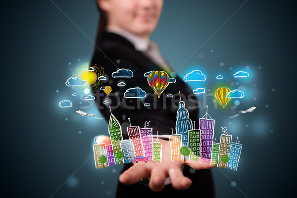 Young woman presenting colorful hand drawn metropolitan city Stock photo © ra2studio