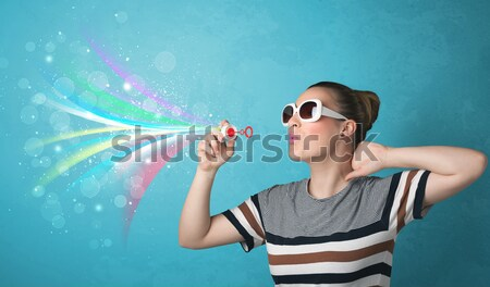 Stock photo: Happy joyful man with sunglasses looking at summer icons