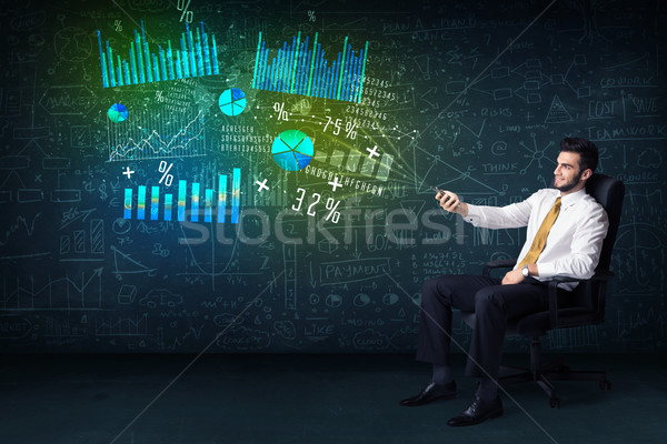 Businessman in office chair with tablet in hand and high tech gr Stock photo © ra2studio