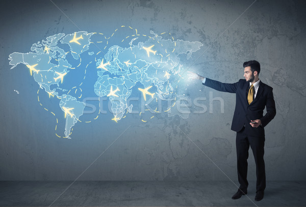 Business person showing digital map with planes around the world Stock photo © ra2studio