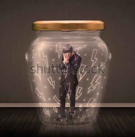 Işadamı içinde cam kavanoz yıldırım çizimler Stok fotoğraf © ra2studio