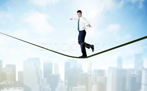 Vendedor caminhada corda acima cidade cidade scape Foto stock © ra2studio