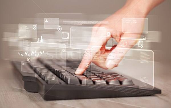 Hand touching keyboard with high tech buttons Stock photo © ra2studio