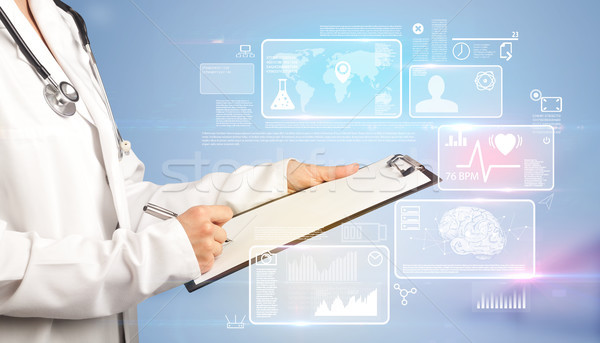 Female doctor with notepad Stock photo © ra2studio