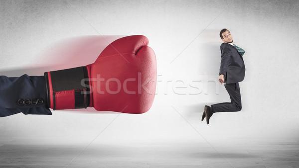Stock photo: Big hand boxing little businessman
