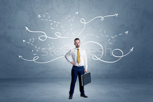 Stock photo: Businessman standing with winding arrows around