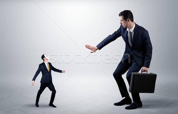 Conflito pequeno grande empresário elegante homem Foto stock © ra2studio