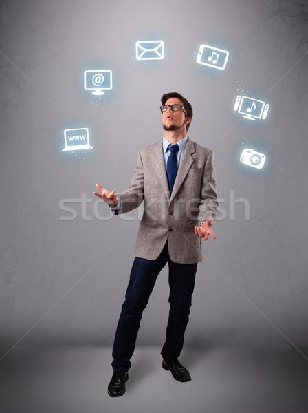 Grappig jongen jongleren elektronische iconen Stockfoto © ra2studio