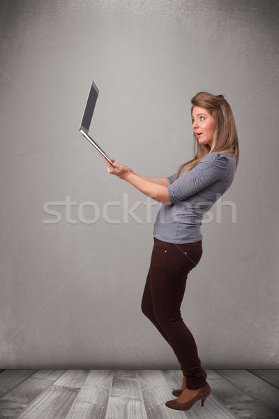 Young woman holding modern laptot Stock photo © ra2studio