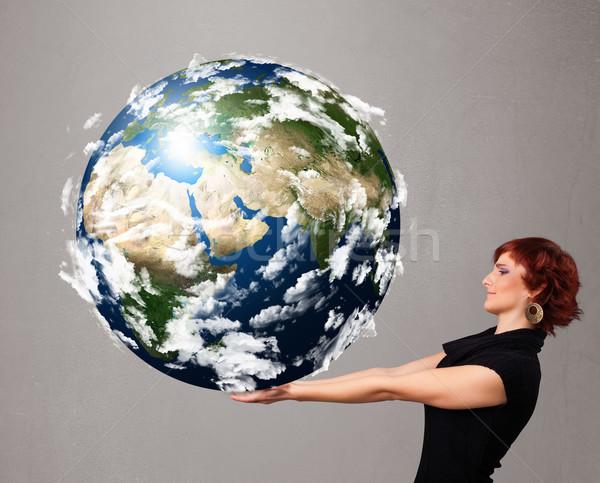 Pretty girl holding 3d planet earth Stock photo © ra2studio