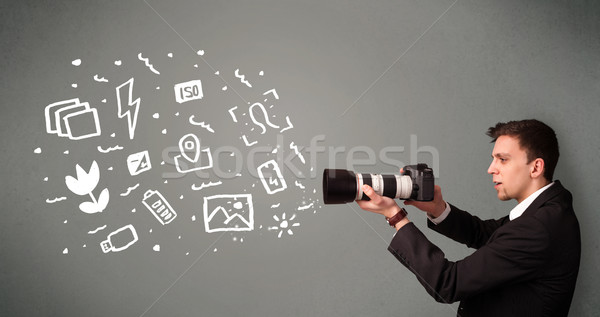 Photographer boy capturing white photography icons and symbols Stock photo © ra2studio