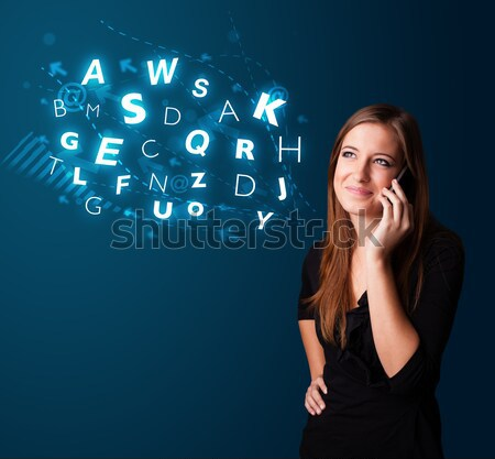 Young lady making phone call with shiny characters Stock photo © ra2studio