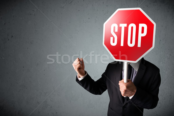 ストックフォト: ビジネスマン · 一時停止の標識 · 立って · 頭 · 手