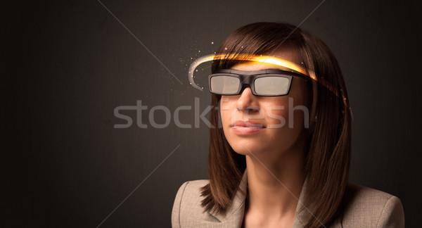 Pretty woman looking with futuristic high tech glasses  Stock photo © ra2studio