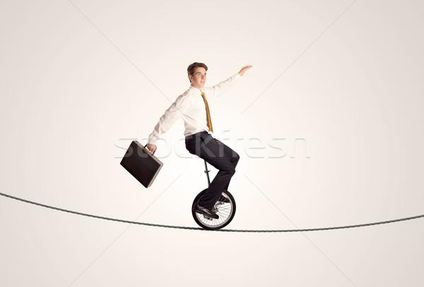 Aşırı iş adamı binicilik halat adam Stok fotoğraf © ra2studio