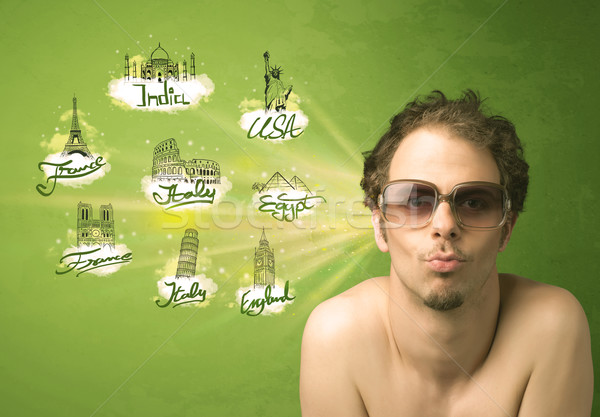 Happy young man with sunglasses traveling to cities around the w Stock photo © ra2studio