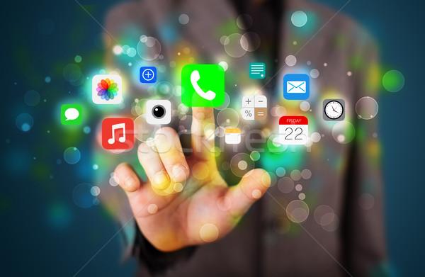 Jóképű üzletember kisajtolás színes mobil app Stock fotó © ra2studio