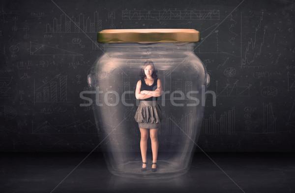 Businesswoman shut inside a glass jar concept Stock photo © ra2studio