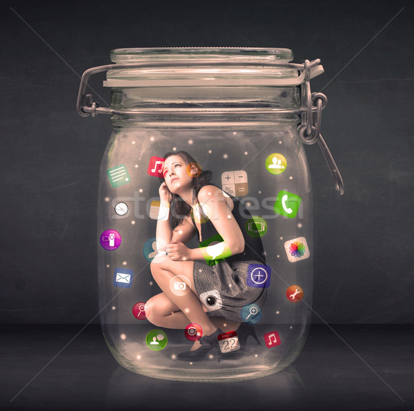 Businesswoman captured in a glass jar with colourful app icons c Stock photo © ra2studio