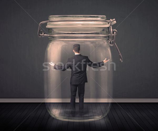 üzletember csapdába esett üveg bögre űr pénzügy Stock fotó © ra2studio