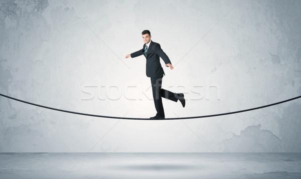 Verkoop vent balancing strak touw zakenman Stockfoto © ra2studio