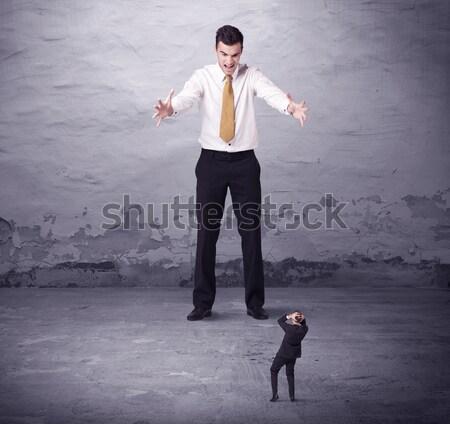 Mérges nagy menedzser néz kisvállalkozás férfi Stock fotó © ra2studio
