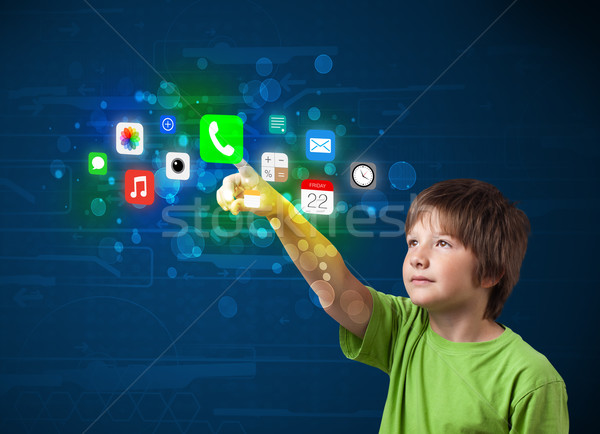 Przystojny chłopca kolorowy komórkowych app Zdjęcia stock © ra2studio