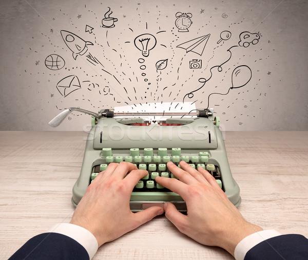Vintage typewriter with doodles around Stock photo © ra2studio