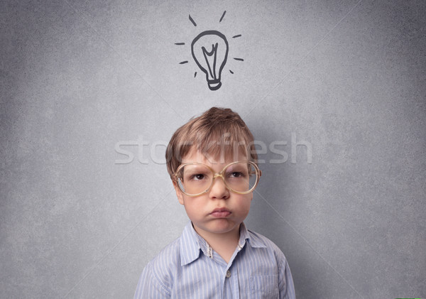 Smart kid in front of a drawn up grey wall Stock photo © ra2studio