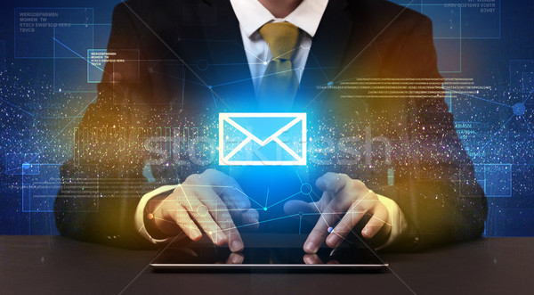 Businessman typing and mailing icon above Stock photo © ra2studio