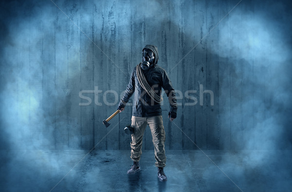 Dreadful man with mask in a wood shanty Stock photo © ra2studio