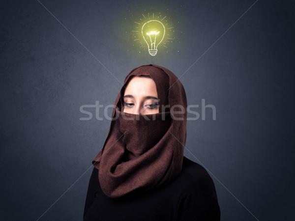 Moslim vrouw jonge gloeilamp boven Stockfoto © ra2studio