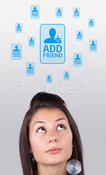 Young girl looking at social type of icons and signs Stock photo © ra2studio