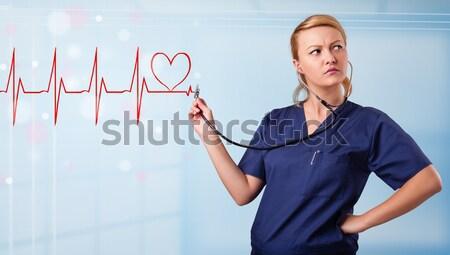 Сток-фото: молодые · медсестры · прослушивании · аннотация · импульс · красный