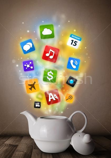 Tea pot with colorful media icons Stock photo © ra2studio