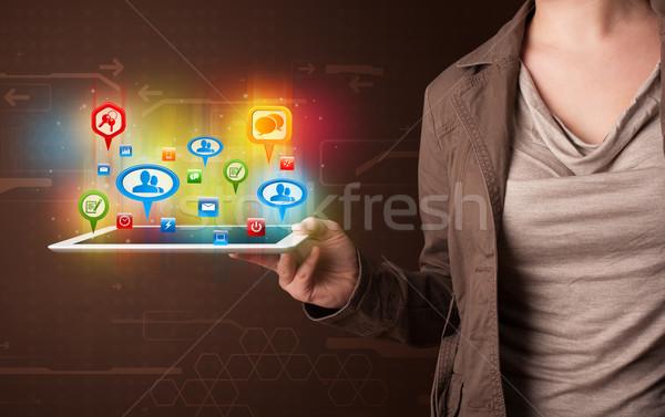 Kız tablet renkli sosyal simgeler Stok fotoğraf © ra2studio