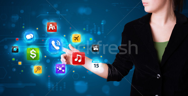 Woman pressing various collection of high tech buttons Stock photo © ra2studio