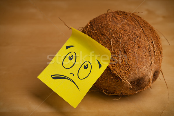Post-it note with smiley face sticked on coconut Stock photo © ra2studio