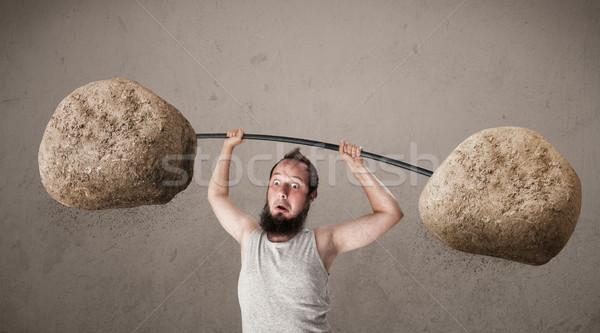 Sovány fickó emel nagy kő kő Stock fotó © ra2studio