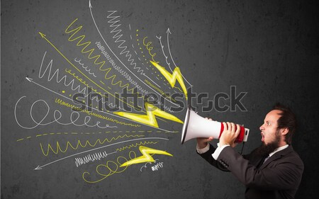 Leader guy shouting into megaphone with hand drawn lines and arr Stock photo © ra2studio