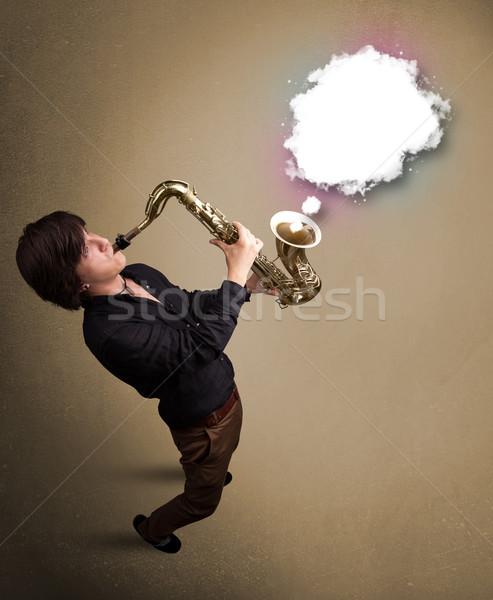 Młody człowiek gry saksofon kopia przestrzeń biały Chmura Zdjęcia stock © ra2studio