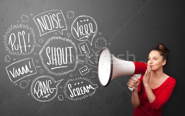 Girl yelling into megaphone and hand drawn speech bubbles come o Stock photo © ra2studio