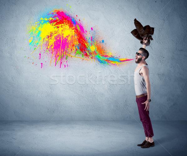 Guy coloré peinture mur Photo stock © ra2studio