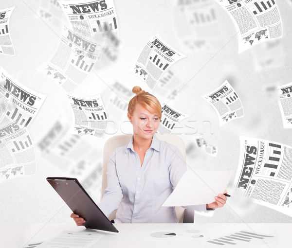 Business woman at desk with stock market newspapers Stock photo © ra2studio