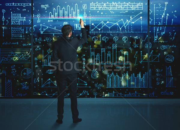 Drawing businessman with statistics background Stock photo © ra2studio