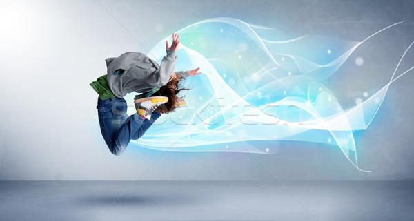 Cute nastolatek skoki streszczenie niebieski szalik Zdjęcia stock © ra2studio