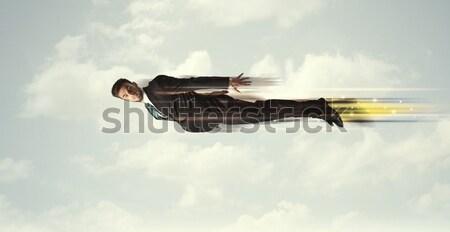 Gelukkig zakenman vliegen snel hemel wolken Stockfoto © ra2studio