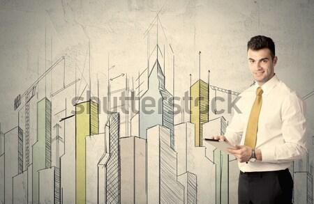 Işadamı ayakta Cityscape duvar Stok fotoğraf © ra2studio